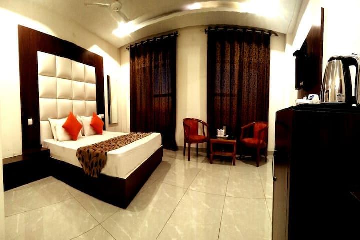 Super Deluxe Room with Hotel Vatika The Riverside Resort