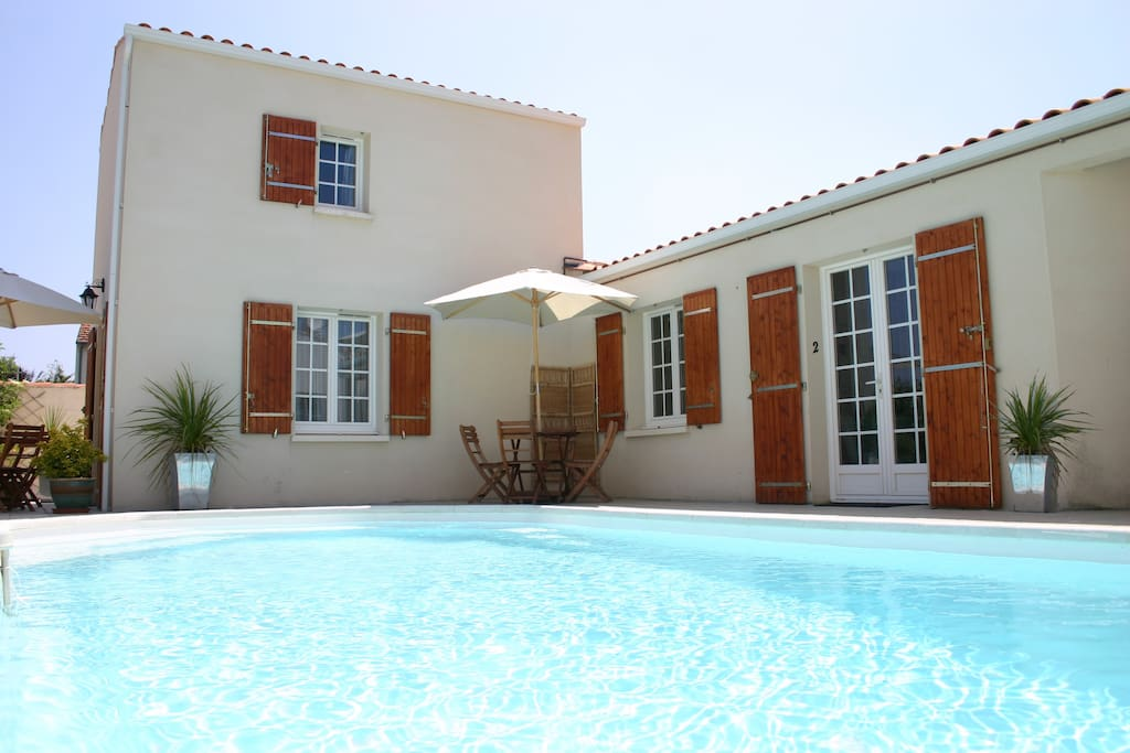 The exterior of the apartment (double door to right of image) leading out onto the shared pool