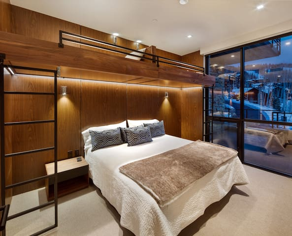 """2nd bedroom with king bed (with pillow-top mattress) and 2 bunk beds above. 65"""" 4k Samsung flatscreen TV, USB power ports everywhere, and ensuite bath! So in total, this room can sleep up to 4 people."""