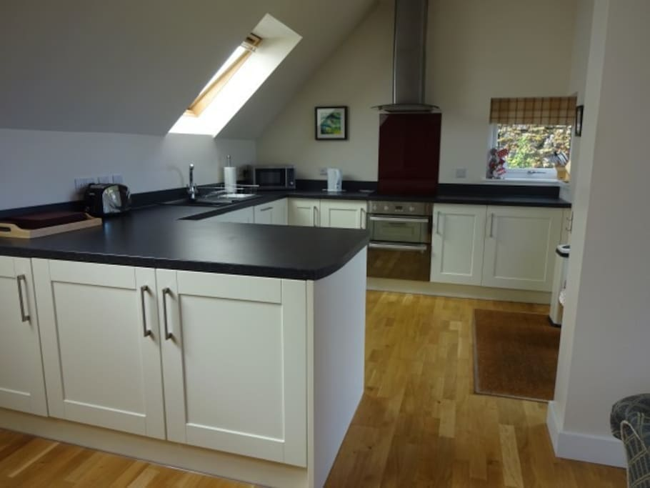 Open plan kitchen complete with fridge, dishwasher and washing machine