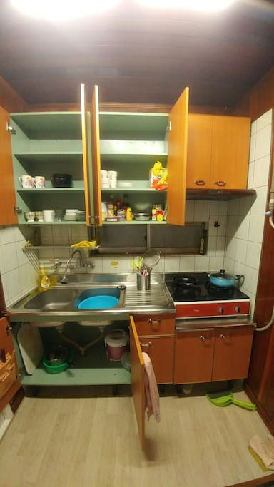 gas stove with kitchenware.