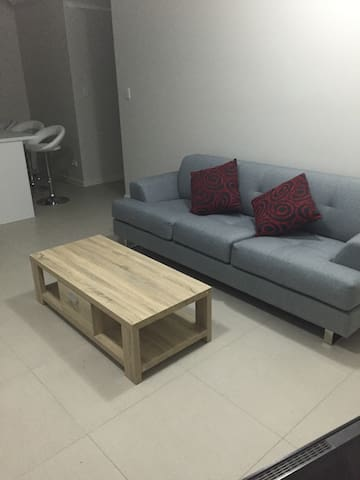 Three seater lounge and coffee table