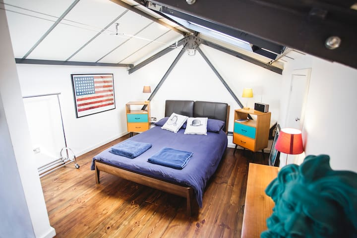 The top bedroom is a large room with an incredibly comfy double bed. There's also lots of storage and cupboard space if you need it.