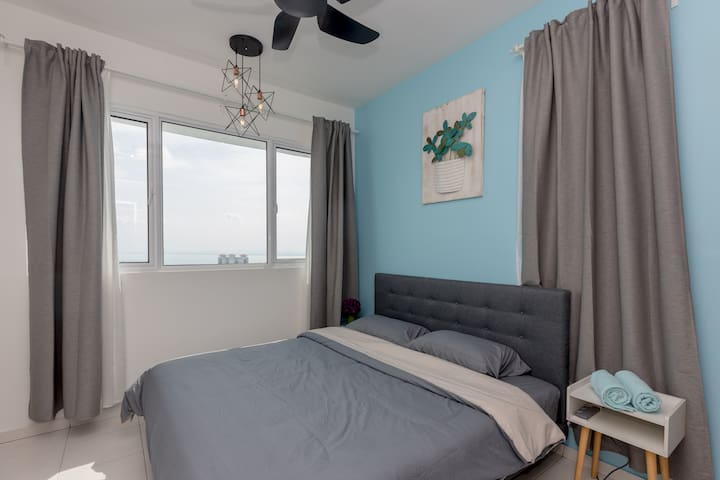Master bedroom with king size bed..