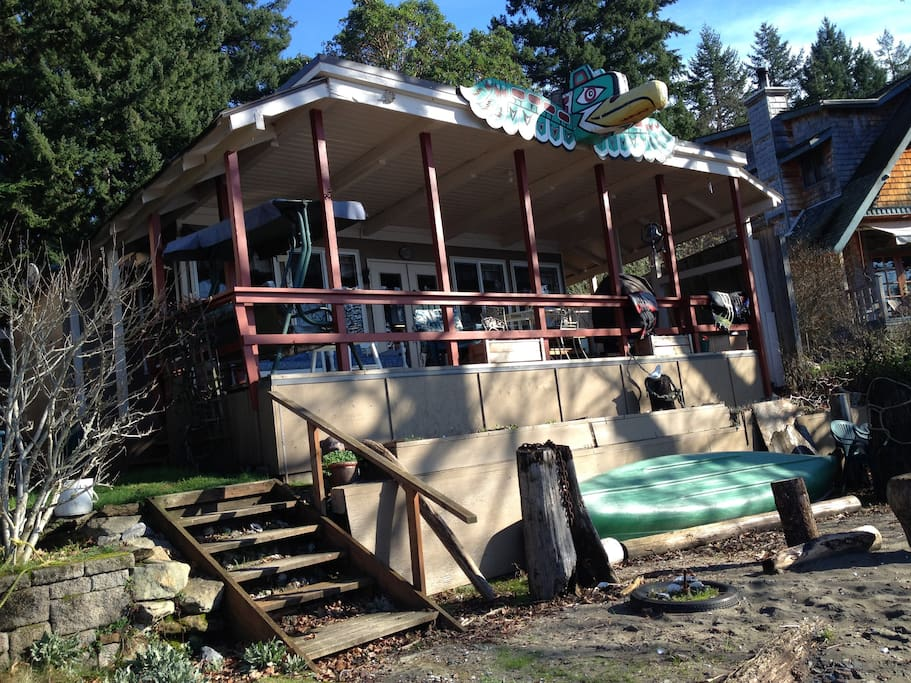 Front view of the cottage overlooking the beach Canoe and lifejackets provided Hot Tub Large deck for gathering
