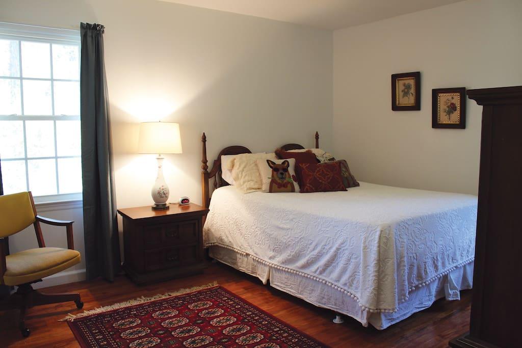 Master bedroom with comfy queen bed.