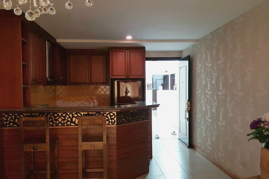 Decorated kitchen with electronic stove, microwave and refrigerator