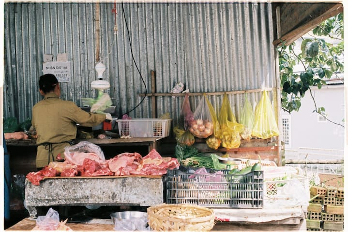 morning grocery store in front of Di house