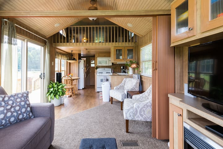 The cabin is open from the kitchen to living room. Kids can keep an eye on everyone from the play loft upstairs.