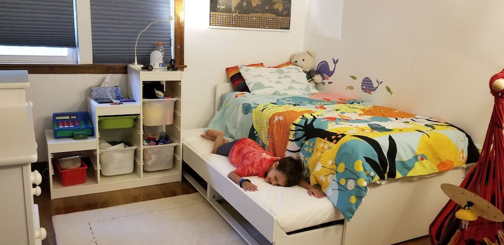 Kids room with trundle bed (it opens up to two full twins