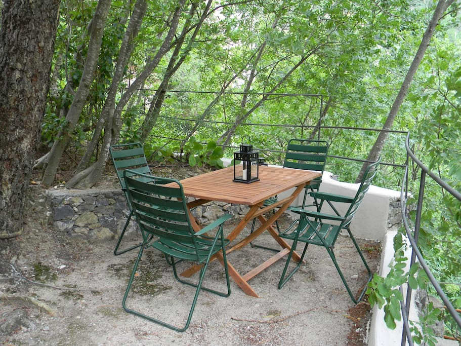 The back side is cosier and secluded, shaded by vegetation, so it is an ideal place for having lunch in summer.