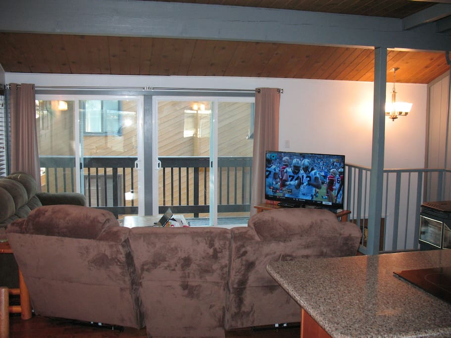 "55"" Smart T.V., private balcony, vaulted ceilings and pellet stove."