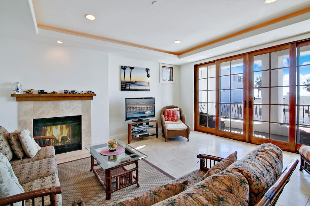 """42"""" TV and fireplace in the living room"""