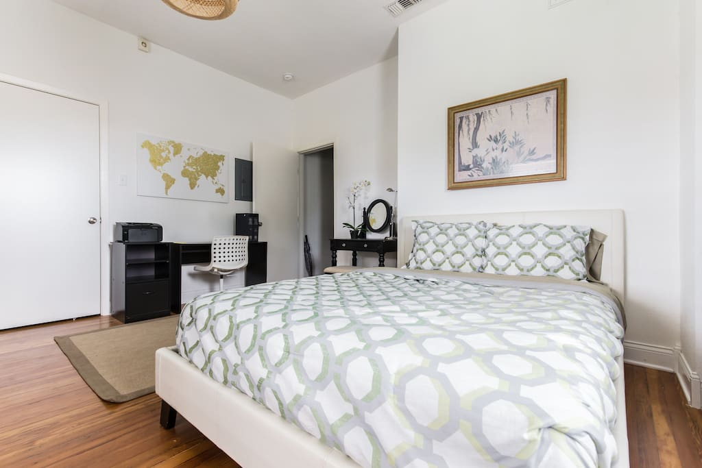 The master bedroom opens onto the balcony and features a queen bed with enough room for a queen air mattress if you're traveling with friends.