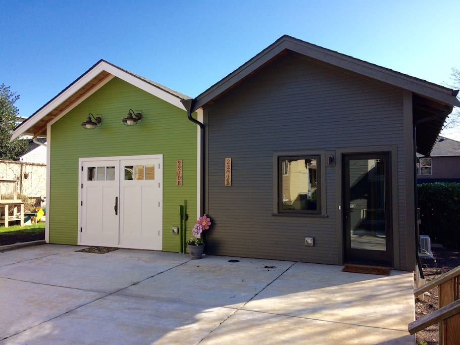 Street facing facade, concrete patio, and entry.  Entry has full lite door and large bedroom casement window. Our unit is the gray colored (2202 B).  We share a common wall at the property line with our neighbors unit (in green).