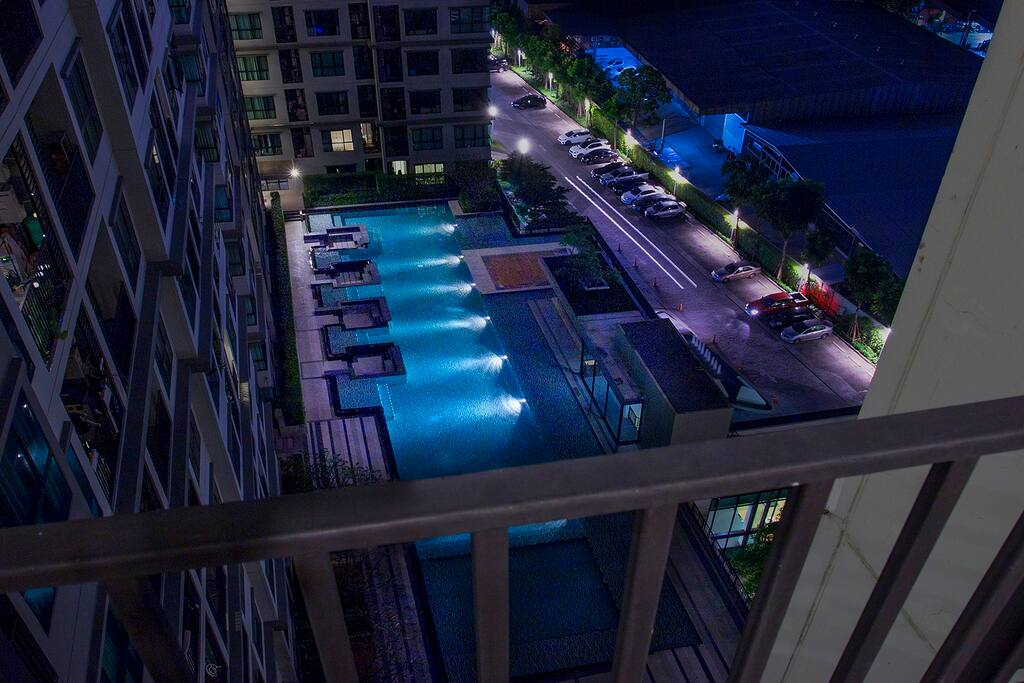 View over a large swimming pool from a balcony