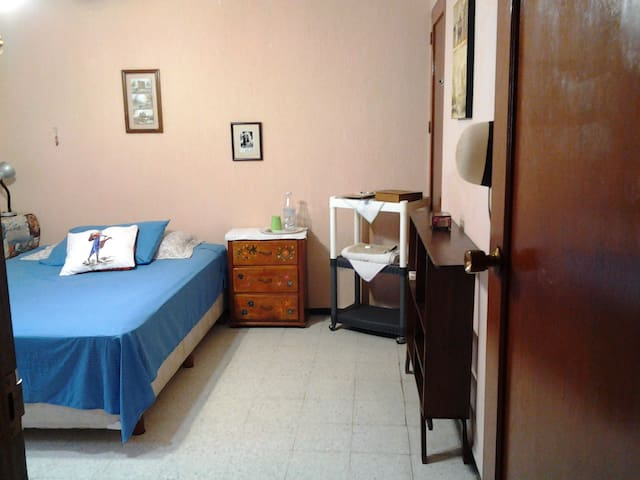 Full size bed and closet available ideal for long stays.