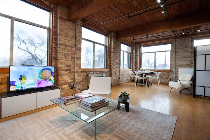 This loft is bathed in light with giant windows.