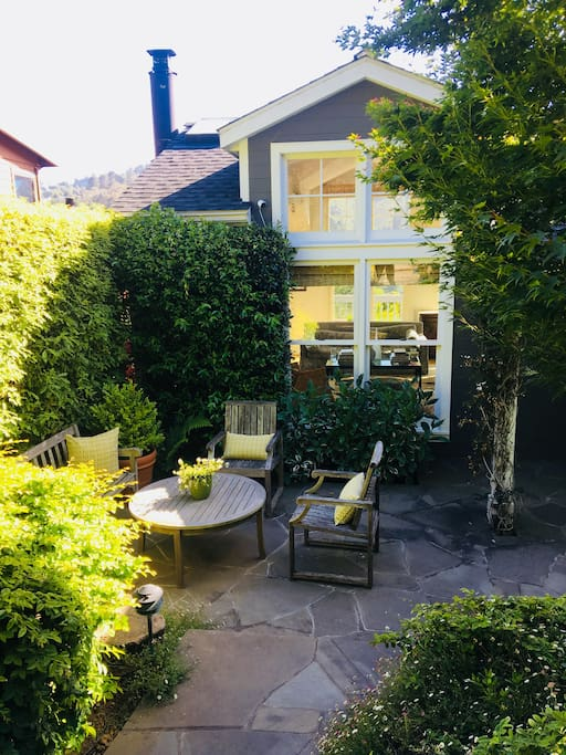 Front patio/garden with teak bench and chairs and plenty of morning sun with your coffee.