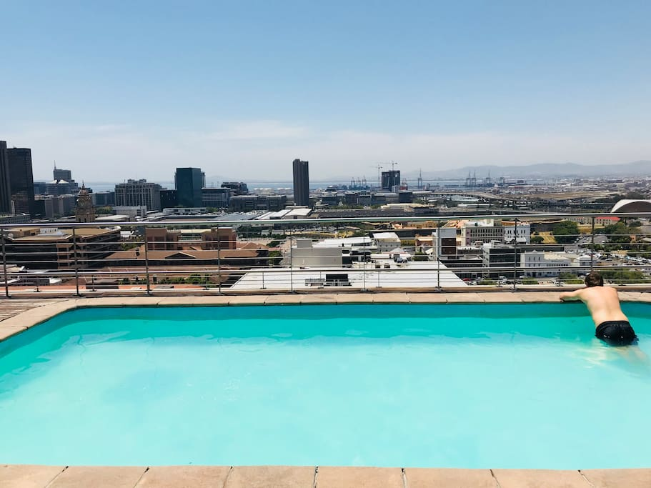 Rooftop Pool with views of down town CBD as far as the port.