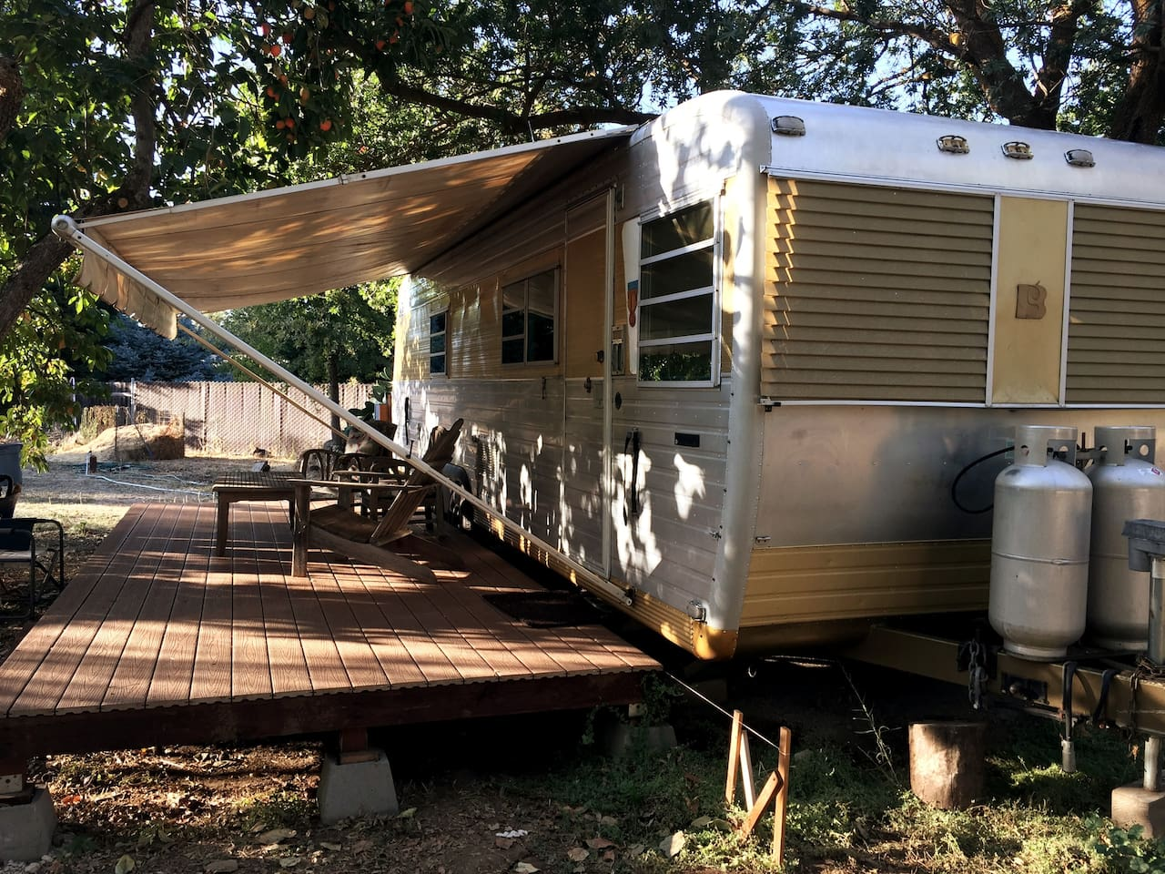 Trailer with awning extended