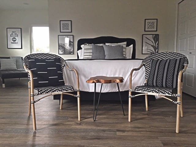 Monochromatic vibes in this unit......a great place to rest your head or take seat.
