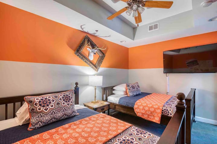 2nd bedroom has 2 full size beds and a 58 inch Smart TV.