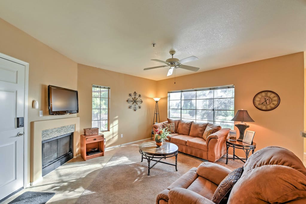 The spacious living room boasts comfy furniture and a gas fireplace.