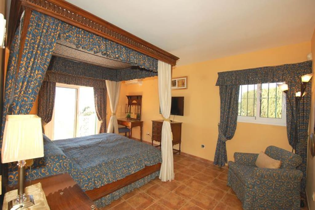 The master bedroom with Four poster bed