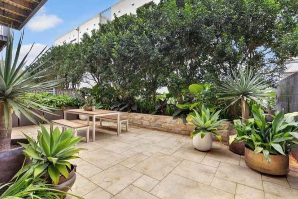 Your very own private garden and terrace with lush tropical garden. Great for breakfasts in the sun, dinner parties, or entertaining.