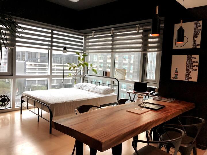 Sleek Black & Wood Corner Studio BGC