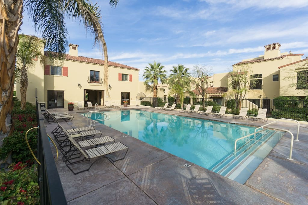 Swim under the palms in the complex's pool
