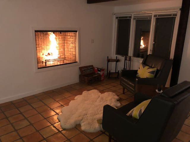 During the winter months cozy up in front of an open fire