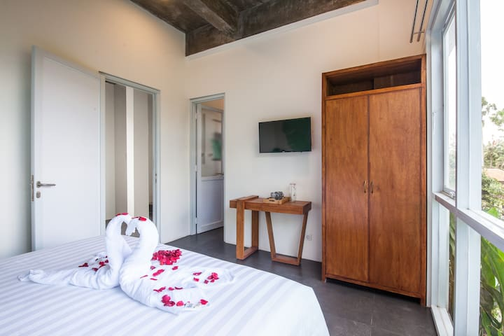 Each deluxe room has a large private bathroom, a wardrobe, a safe, a TV, and a writing desk with a chair (chair not in photo)