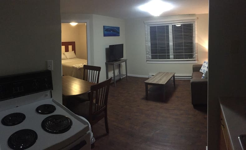 Living room, kitchen & dining table.