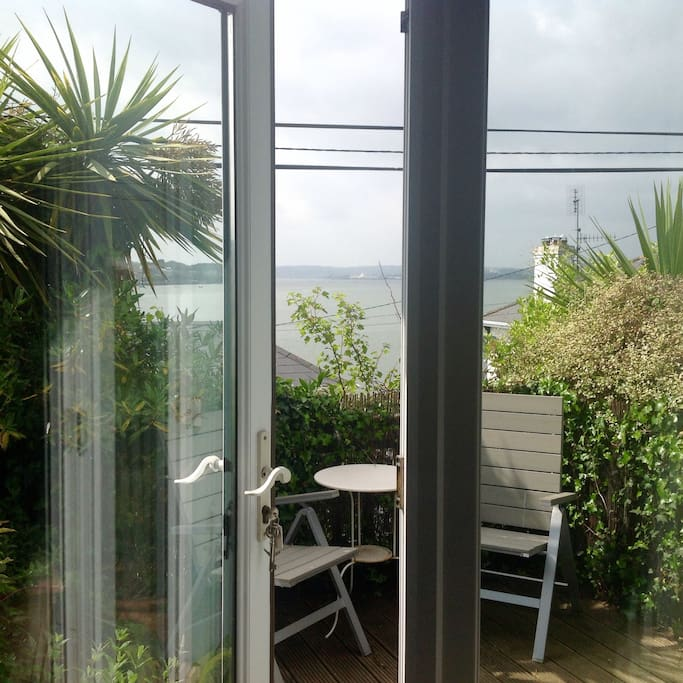 French doors from bedroom to private terrace somewhere to unwind with a glass of wine after sightseeing.