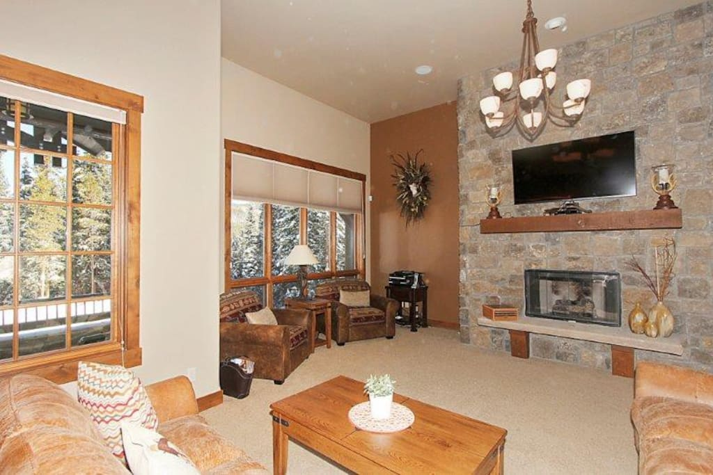 Cozy up with family next to the fireplace and flatscreen TV