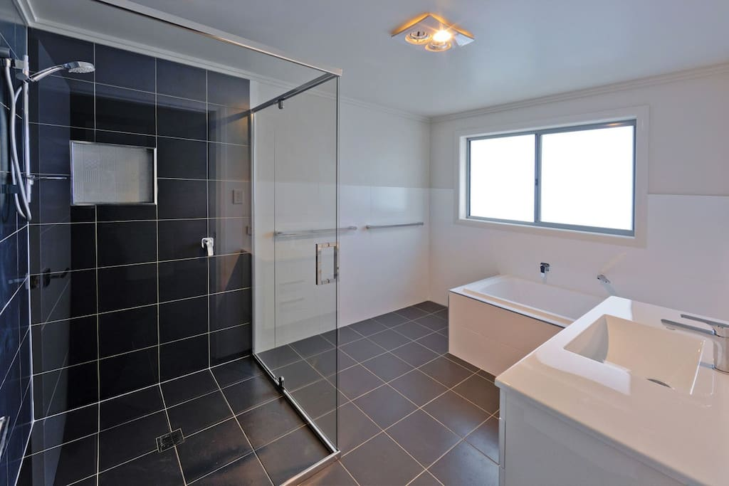 Large new bathroom all to yourself. An oversized shower and a relaxing bath awaits.