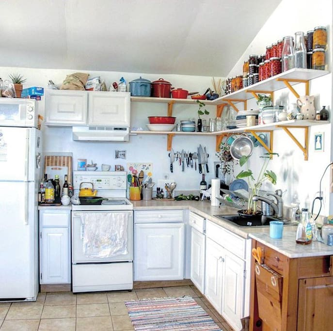 Kitchen, small, but stocked with everything you'll need to feel at home