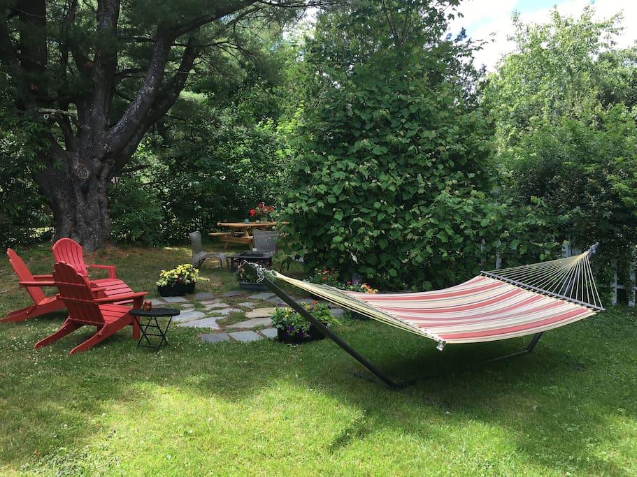 Beautiful backyard garden,  volleyball net, fire pit, BBQ grill.