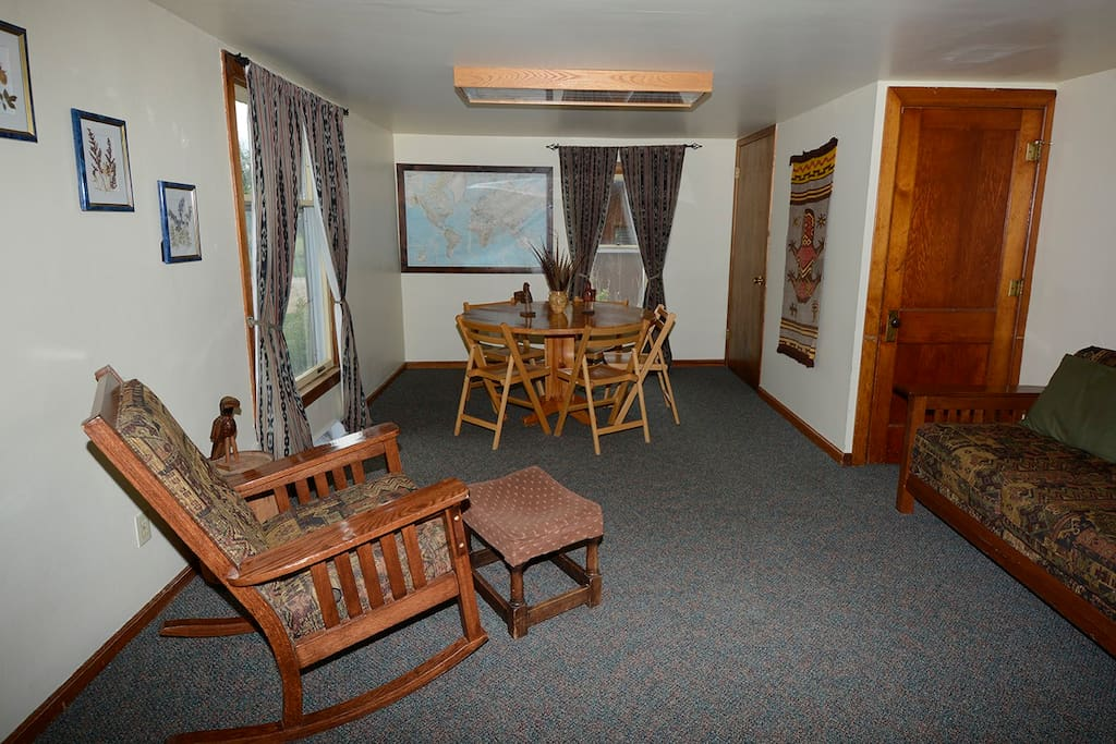 Living Room looking East. Additional round tables are available in the closet.