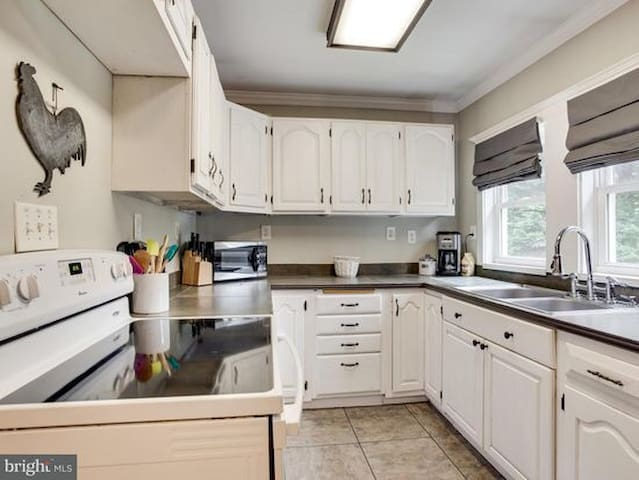 Kitchen is very well outfitted for all cooking needs, quality cookware & knives, lots of accessories. Additional items such as smoothing maker, crock pot, mixer, serving dishes, toaster oven, etc. No automatic dishwasher, so sorry :(