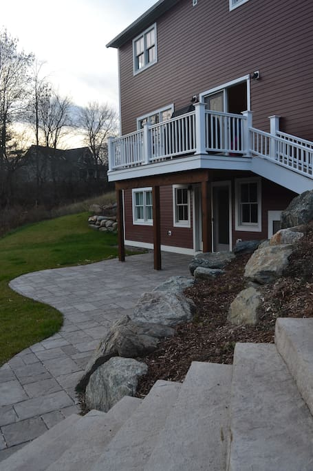 Deck and patio in back....we can make sure the firepit is ready for you, too.
