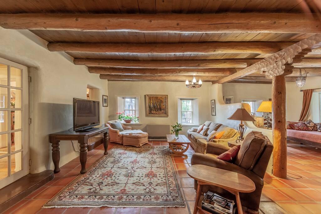 Comfortable goose down sofa and elegant persian rugs enhance the unique puebloan architecture.