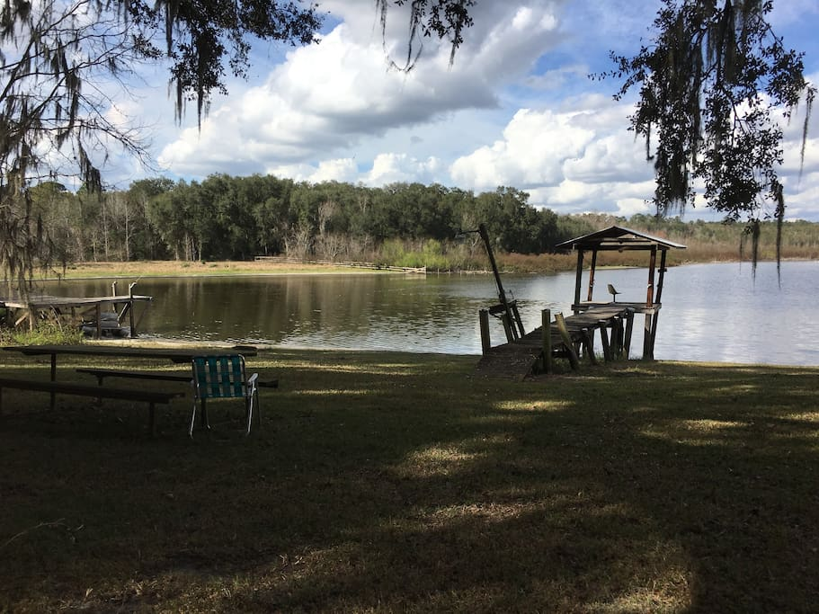 Preliminary photo. Private fishing dock. Boat, canoe and fishing poles provided. The water has raised since photo. Lol, Also better lawn furniture.