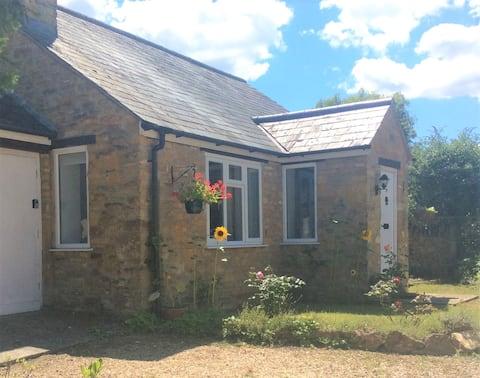 Detached stone bungalow in pretty Somerset village