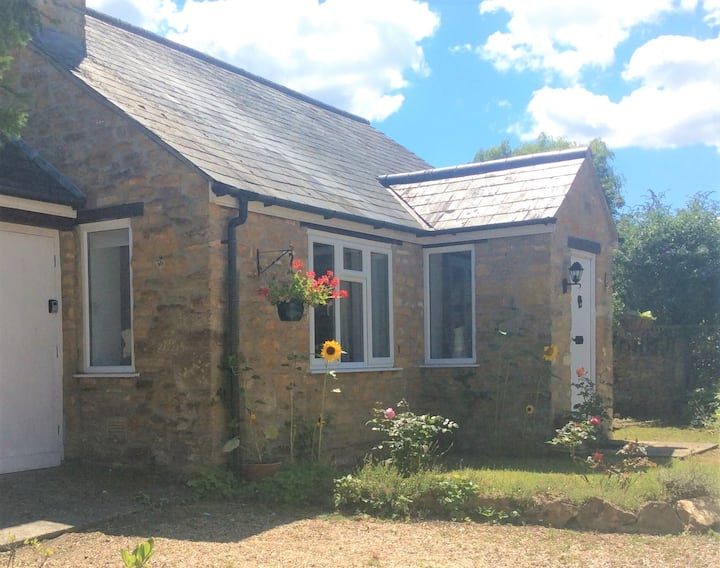Detached stone bungalow in pretty Somerset village