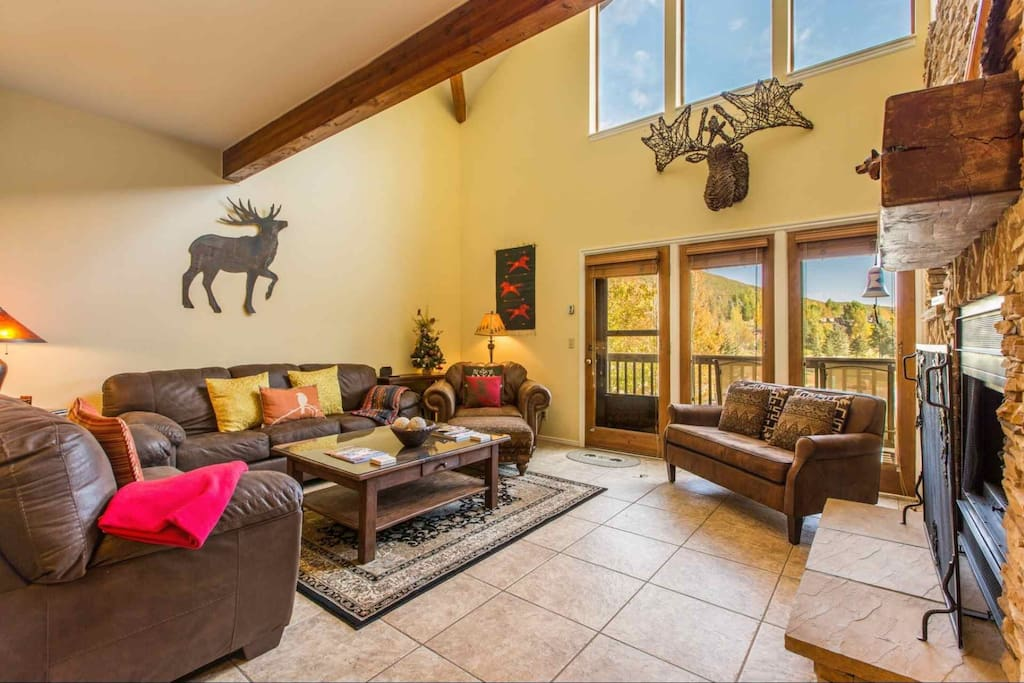 Situated just off of the living room is the private balcony and deck with views of Deer Valley Resort in Park City, Utah.