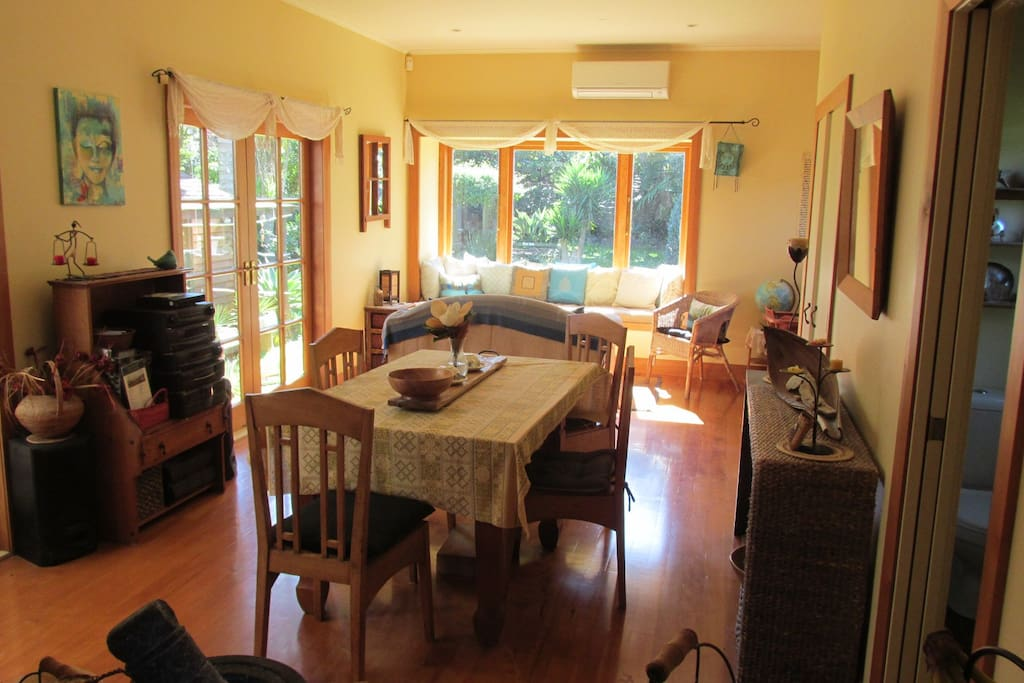 shared dining and sitting room facing garden