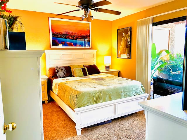 Get a great night's rest in the main bedroom, which features a comfortable queen-sized bed and connected balcony and connected bathroom.